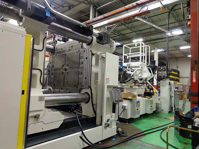 Installation Of New Milicron 2300 Injection Molding Press
